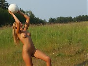 Two juicy nude coeds playing ball outdoors