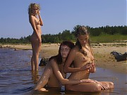 Smeared with cream beach teens exposes their pussy on orient beach